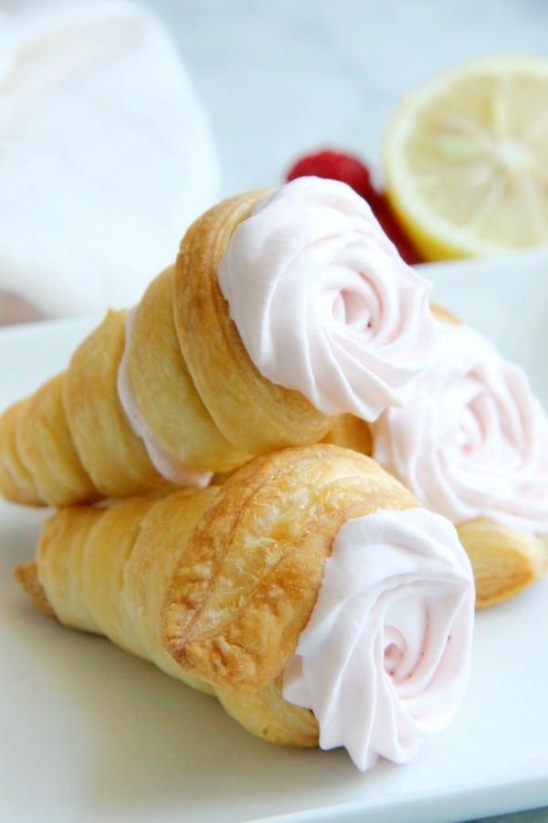 Lemon Raspberry Cream Horns stacked on white plate