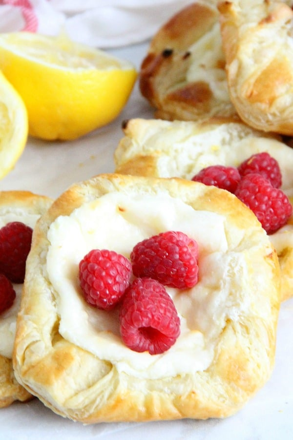 Lemon Raspberry Danish on parchment paper