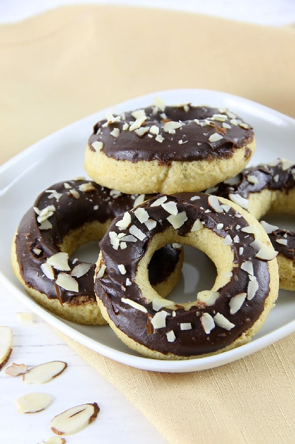 Chocolate Almond Glazed Donuts on white plate