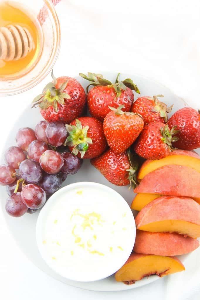 Honey Yogurt Dip overhead view in white bowl topped with lemon zest