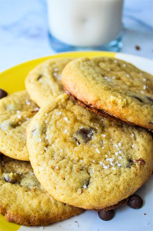 Sea Salt Brown Sugar Chocolate Chip Cookies stacked on yellow plate