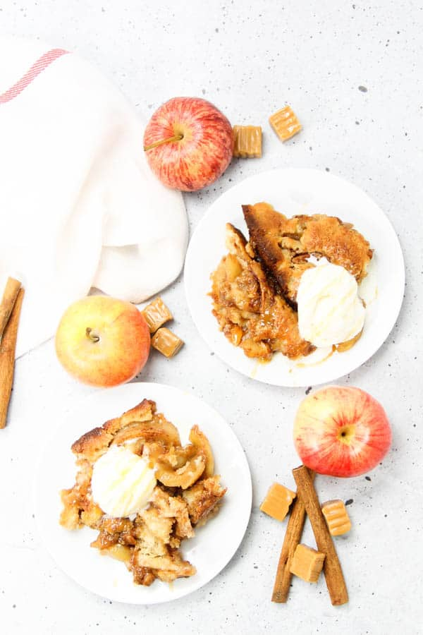 Caramel Apple Cobbler overhead view on plates with ice cream