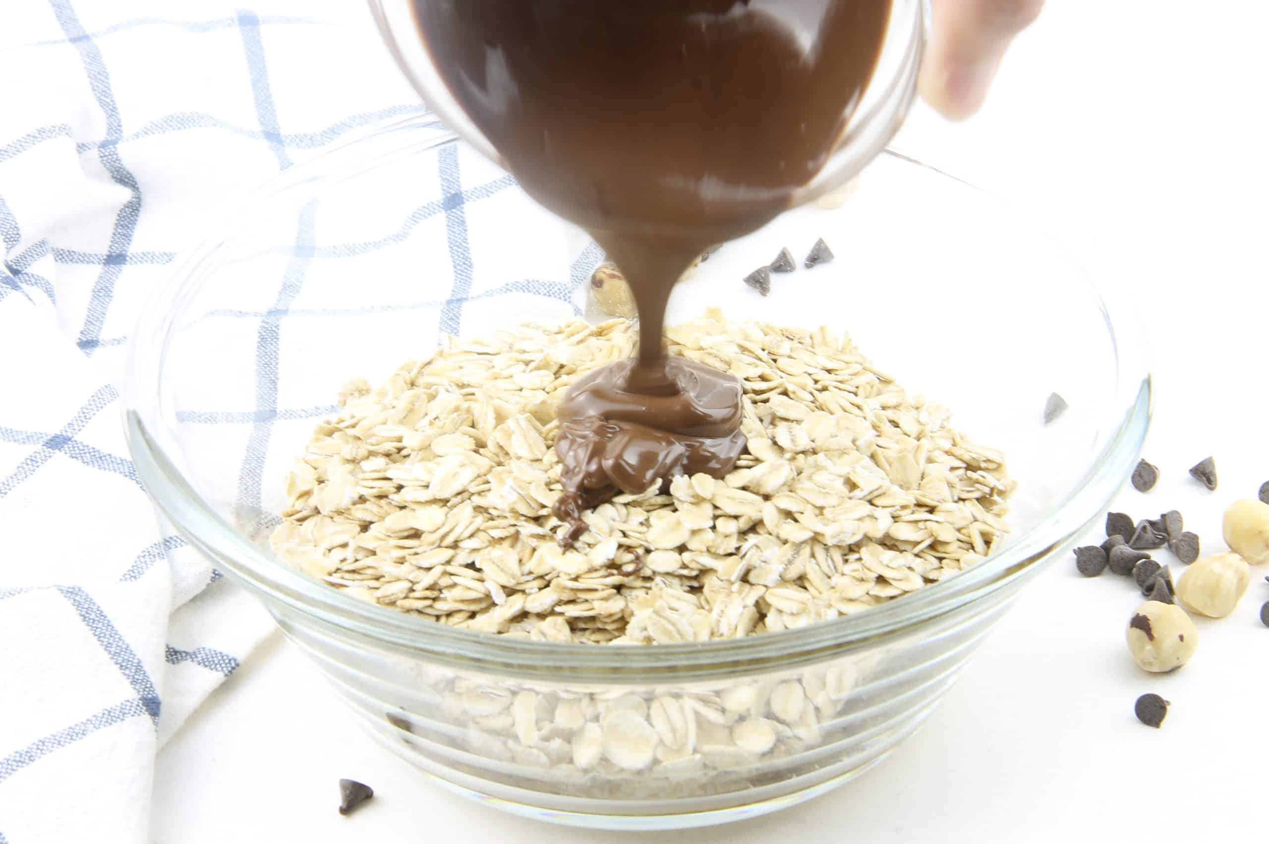 Chocolate Hazelnut Granola nutella being poured in bowl