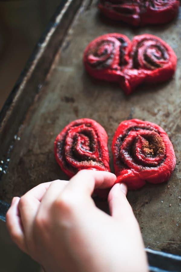 Red Velvet Cinnamon Rolls on sheet pan