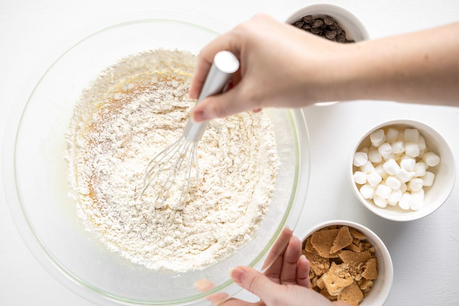 whisking flour in glass bowl.